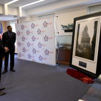 STEEL STANDING MEMORIAL FOUNDATION founder Anthony Whitaker looks on as FDNY Commissioner Mr.Daniel A. Nigro takes a step back to ponder the profoundness of the iconic STEEL STANDING photographic image. 11/21/2016