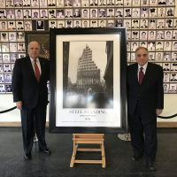 The distinguished Mr. Stephen L. Ruzow, and Mr. Steve Gold, Chairman of the F.D.N.Y. Foundation and Managing Director of the Steel Standing Memorial Foundation respectively, captured here next to a gifted Steel Standing custom framed print to the F.D.N.Y. Training Academy. 02/16/2017
