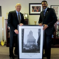 Anthony Whitaker Presents a Framed Custom Print of Steel Standing to U.S. 4 Star General, Colin L. Powell.