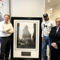 Mr.Stephen Meringoff, Managing Partner of Himmel + Meringoff Properties, Inc. Mr.Anthony Whitaker, Founder of the Steel Standing Memorial Foundation, and Mr.Stephen Gold, Managing Director of the Steel Standing Memorial Foundation, pictured standing in Mr.Meringoff's office next to a custom framed iconic limited edition Steel Standing Print. Mr.Stephen Meringoff acquired the iconic limited edition Steel Standing Print at the FDNY Foundation Dinner 05/11/2017.