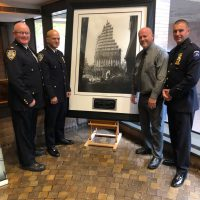 Captured here standing next to the NYPD's Limited Edition Print of Steel Standing in the Hall of Hero's at One Police Plaza, from the left, Lt. Kevin Lee, Chief Philip Rivera, Mr. Jeff Heath, and Mr. Heath's Step Son who was recently promoted to Detective, Detective Timothy Craft. The NYPD's Steel Standing Limited Edition Print is numbered 23 out of 3000 to honor the 23 of the NYPD that made the ultimate sacrifice on 9/11. There are 3000 Limited Edition Steel Standing Prints in total to honor and recognize all of the 3000 souls that were lost on September 11, 2001. Mr. Jeff Heath standing 3rd from the left, owner of Heath Architectural Woodworking custom mills and fabricates all of the wood frames that display the iconic Steel Standing Photograph.