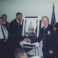 Anthony Presents A Copy of the Iconic STEEL STANDING to NYPD