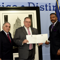 Steel Standing Memorial Foundation Founder Mr.Anthony Whitaker and Steel Standing Memorial Foundation Managing Director Mr.Stephen Gold present The Superintendent of the PAPD Mr.Michael Fedorko the Certificate of Authenticity of the Historical and Iconic Steel Standing Photograph.