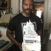 Artist, and Steel Standing Memorial Foundation Founder Anthony Whitaker working in his art studio in Harlem New York bringing his vision of the Steel Standing Memorial Monument to life. Pictured here holding the delicate masterpiece 3D printed facade of the architectural Steel Standing Memorial Monument model.