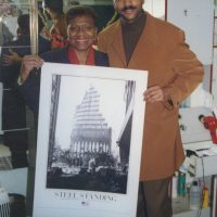 Anthony Whitaker, Steel Standing Memorial Foundation Founder and creator of the iconic Steel Standing photograph, presenting Manhattan Borough President, C. Virginia Fields, a copy of the Steel Standing offset poster print.