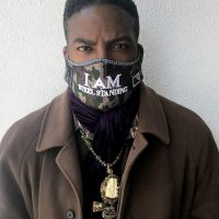"Anthony Whitaker, Founder of The Steel Standing Memorial Foundation captured here wearing a face mask he designed incorporating the powerful mantra ""I AM STEEL STANDING"". The face mask was created in response to the Covid-19 Global Pandemic to serve as an affirmation to overcome the crippling disease."